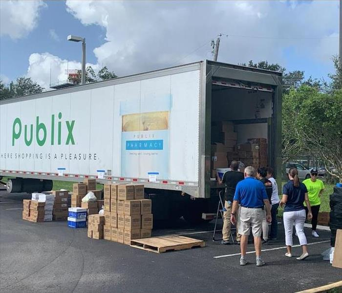 publix truck being loaded with boxes