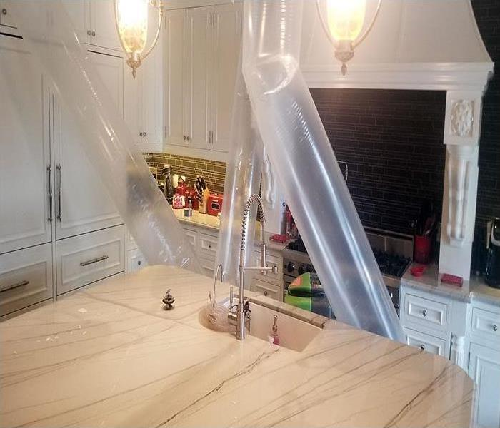 kitchen with plastic tubes directing forced air