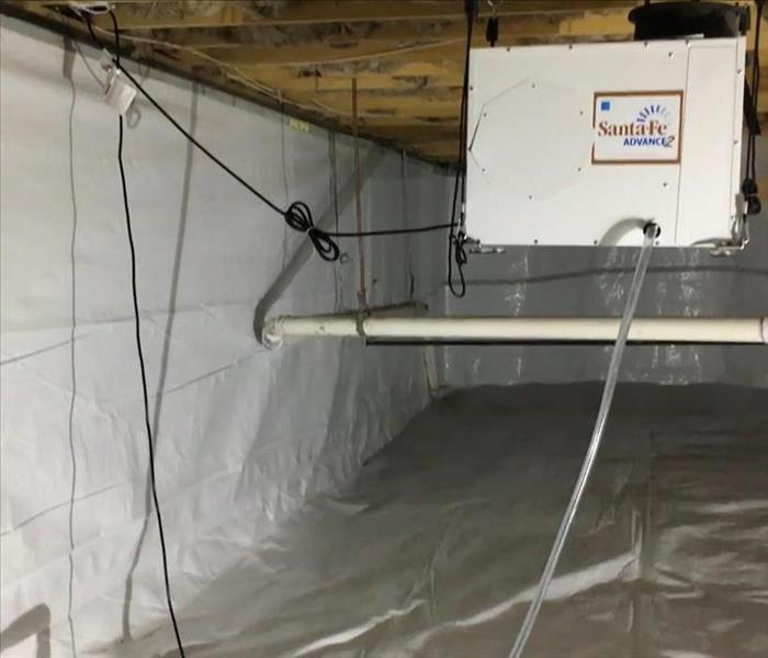 high crawlspace with poly sheeting and a dehu